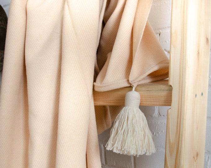 Handmade peach throw blanket with cream fringe