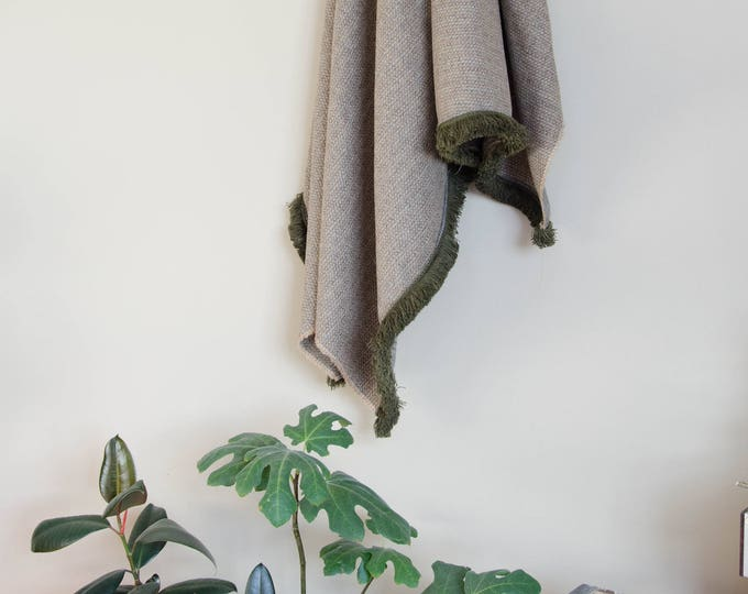 Handmade grey throw blanket with green trims