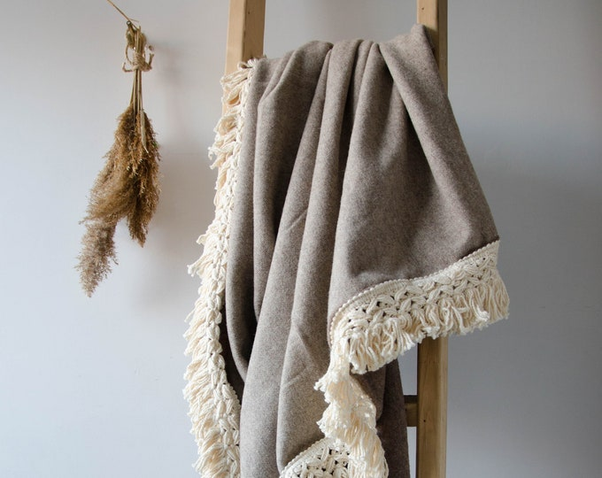 Handmade beige throw blanket with cream fringe