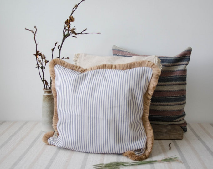 Decorative cushion cover. White and blue stripes, pink trim