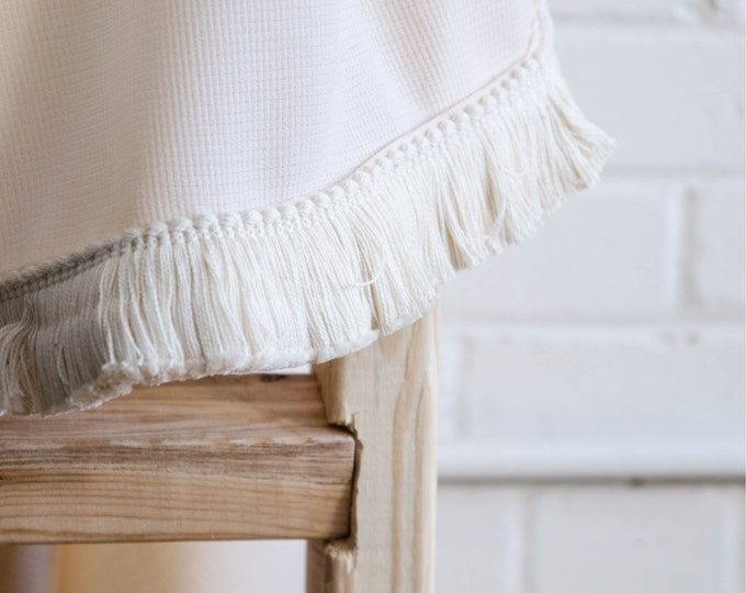 Cream with white fringes throw blanket