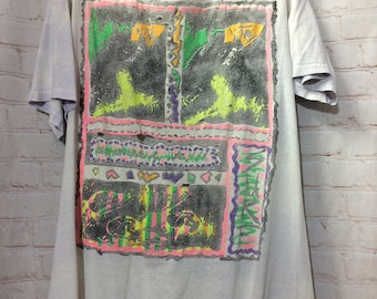 2b2a43ea24f Vintage T-shirt Distressed 1980 s Neon-colored Fish   Surf Graphic