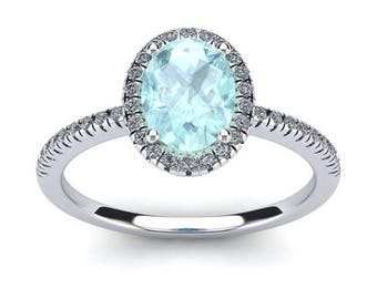 14K white Gold 1 1/3 CT Oval Aquamarine and Diamond Halo Ring