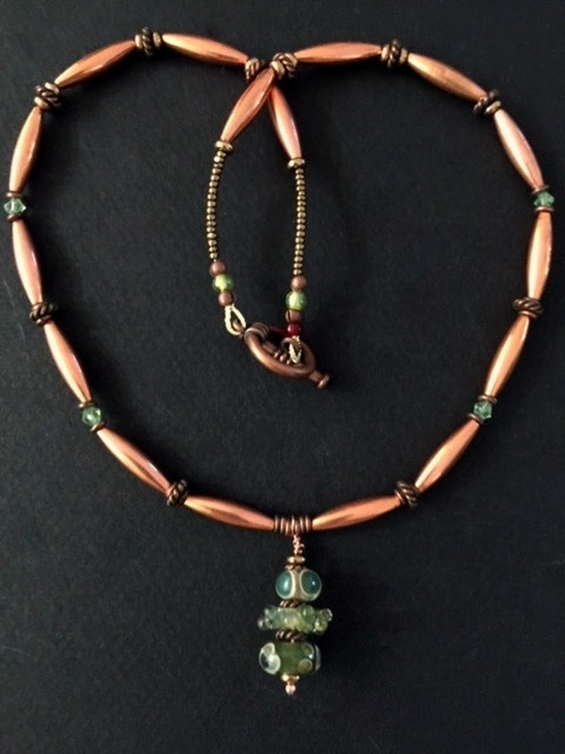 Handcrafted Three Sage Green Lampwork Beads on an Oval Copper Necklace