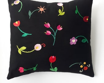 Hand embroidered floral cushion.