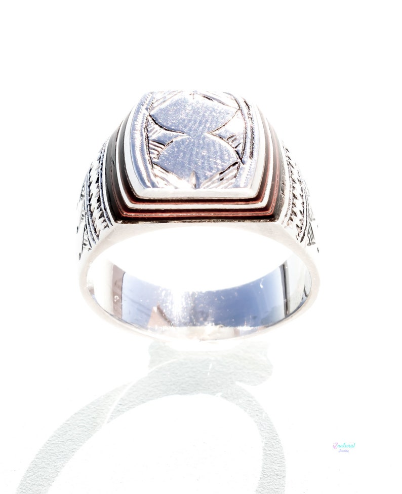 Tuareg ethnic silver ring with carved tribal wood inlaid.