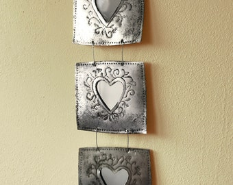 New item! Small triple mirror, made from recycled metal and vintage book pages