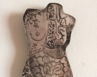 Etched metal rendering of anatomical drawing of the human torso