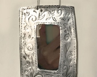 Little oblong mirror made from hand-stamped, recycled tin.