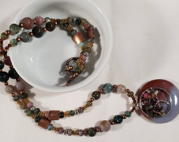 garnet and 3 metal pendant with a Tree of Life wirewrapped on to Jasper pendant. Trees in the Forest is a jasper