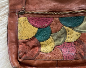 Amazing vintage fossil bag, totally lived in brown leather, with suede patchwork front pockets, scuffed, lived in, bohemian style