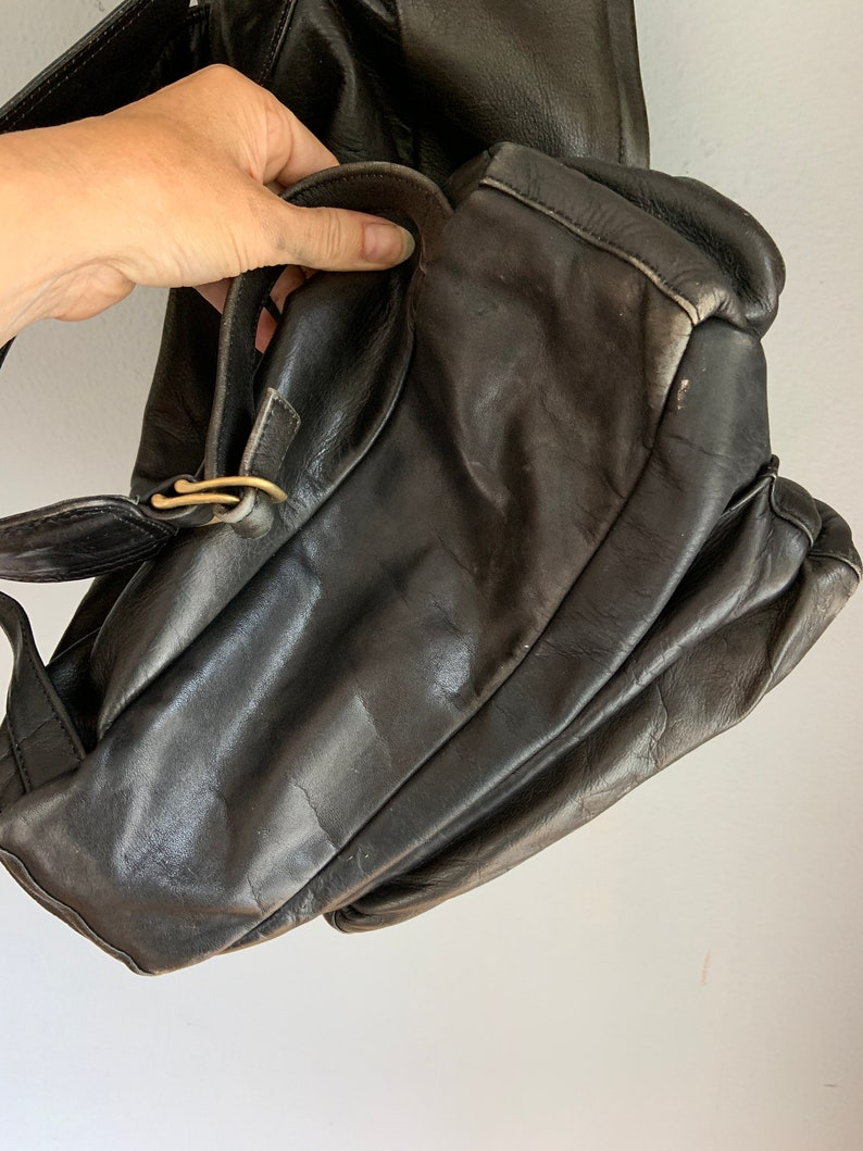 unisex scuffed burgundy interior masculine made in Canada Vintage black leather backpack thick leather organic lived in look
