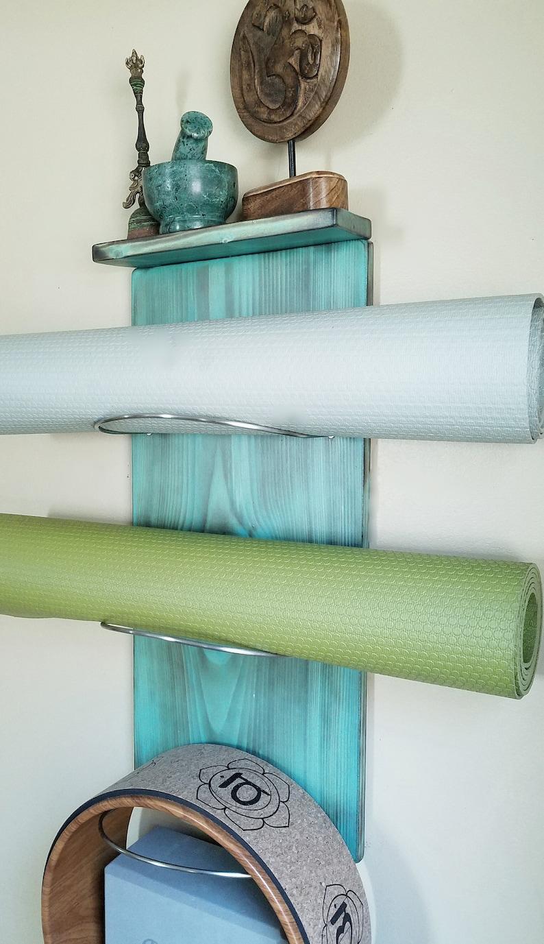 1 thru 8 tiered Yoga Mat Holder w/ a Top Shelf image 0