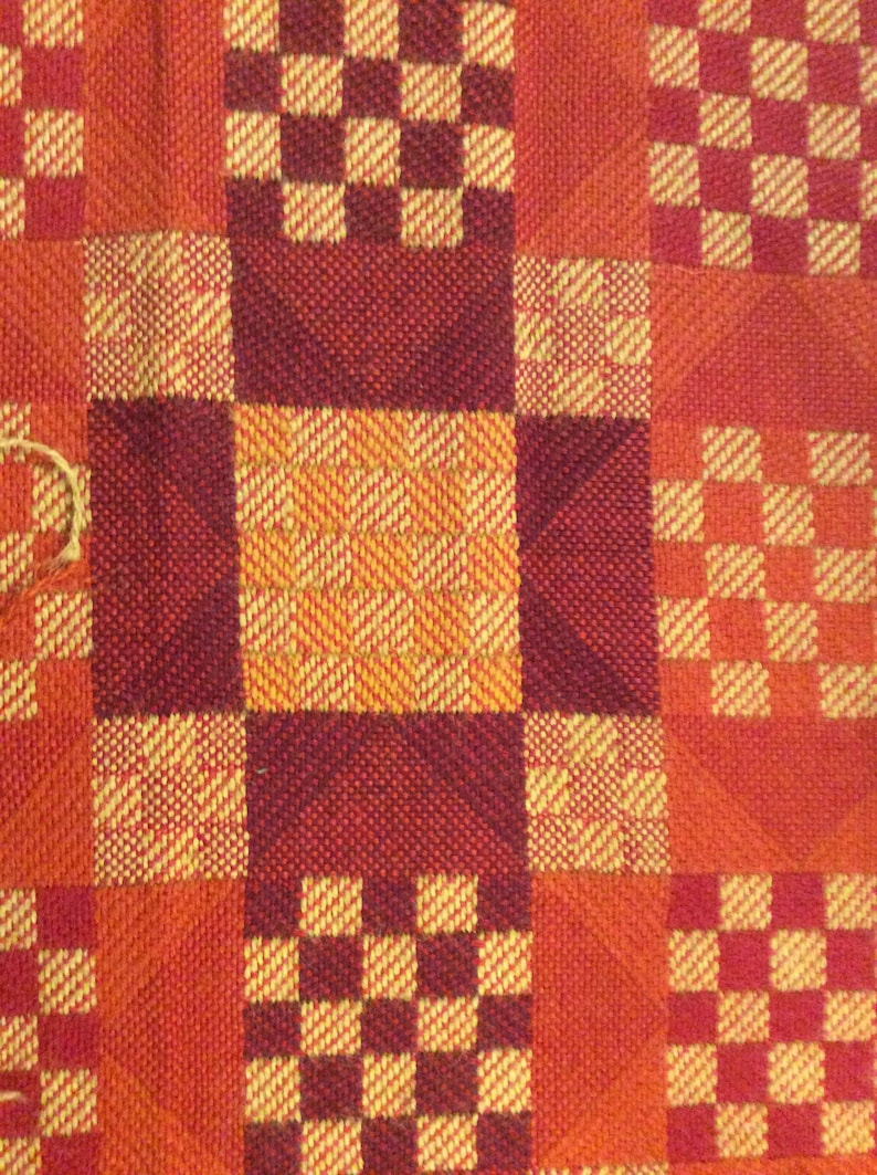 BTY Cool retro upholstery fabric Oranges Reds Checkerboard design