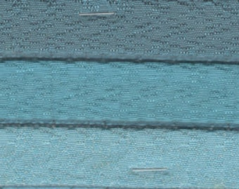 Almost 2 yards 1961 Buick padded channel turquoise upholstery w/flaw