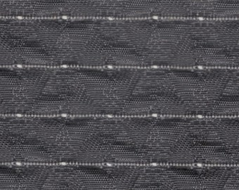 BTY mid century black 3 D puffy woven plastic auto upholstery