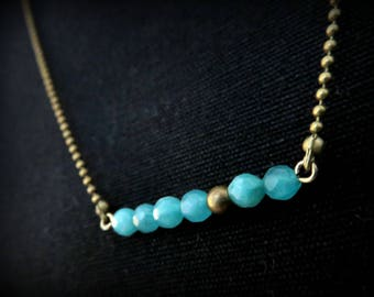 Necklace asymmetrical six faceted blue agate beads hand and brass bead