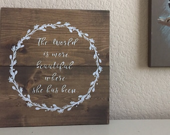 The World is More Beautiful Where She Has Been - Rustic Wooden Sign