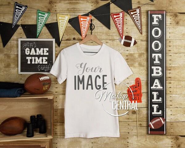 Blank White Football T-shirt Apparel Mockup Clothing Styled Stock Photography Mock Up Shirt On Hanger Sport Background - Jpg Download Unisex Tshirt