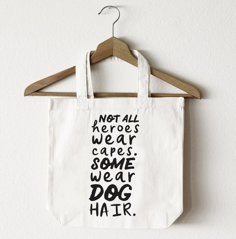 All Over Print Bag Shoulder Bag with Words Not All Heroes Wear Capes Some Wear Dog Hair Typography Tote Bag Black White Totes Carry-All