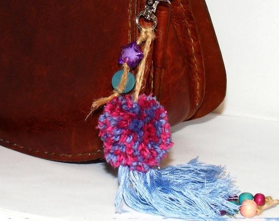 Bijou de sac pompon
