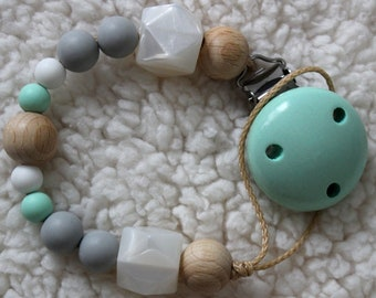 Pacifier mint of natural wood, silicone and crochet