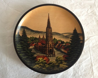 "German Plate Hand Painted Wood 1979 Cathedral and Village Scene 8.5"" Across"