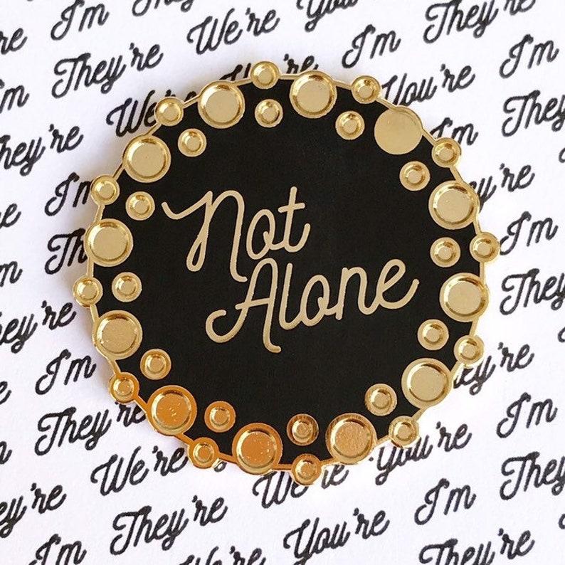 Not Alone enamel pin in support of Fertility Network UK. image 0