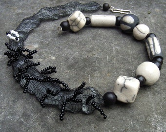 Necklace medium long ceramic raku seed beads glass wooden beads black white Artisan unique ethno Africa boho hippie design plain layered look