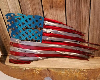Tattered and Torn American flag metal art. aluminum. Do not buy a steel one, it will  rust. Available in both painted and unpainted.