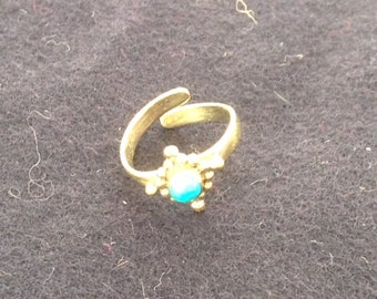 Toe ring or knuckle, brass and turquoise.