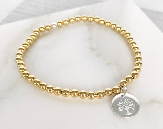 Tree of life gold beaded bracelet with silver plated tree of life charm. Gold boho bead stacks