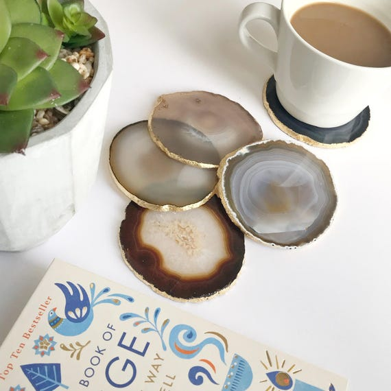Agate coasters natural colours cream beige grey agate slices gilded with gold leaf edging. Bohemian home decoration. Agate slices