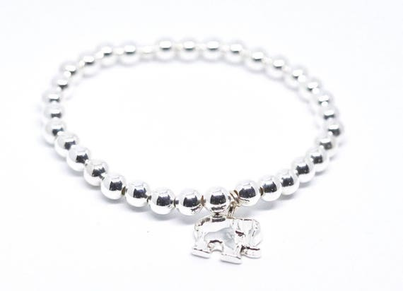 Silver beaded bracelet with elephant charm. Silver boho bead stacks. Stacking bracelets.
