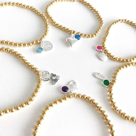 Birthstone charm bracelet with gold plated beads. Silver charms. Personalised jewellery. Design your own bracelet.