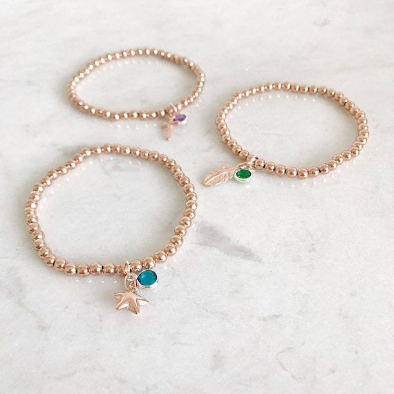 Birthstone charm bracelet with rose gold plated beads. Silver or rosegold charms. Personalised jewellery. Design your own bracelet.