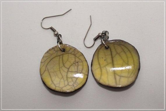 Ceramic earring yellow Raku.