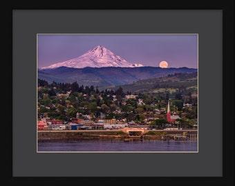 Sunrise illuminates Mt. Hood and setting full moon over The Dalles