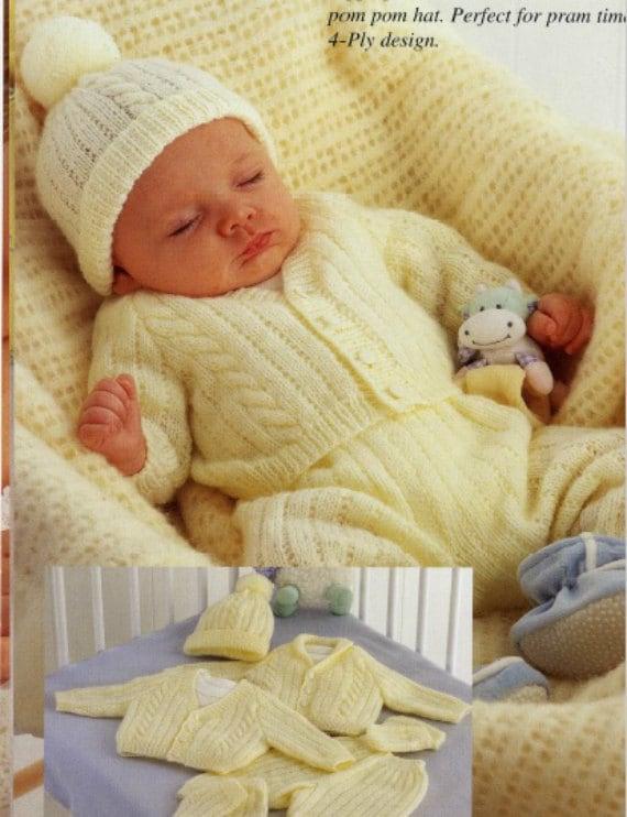 baby cardigans and helmet aran knitting pattern 127