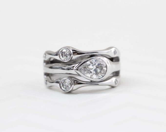 Featured listing image: Horizontal Bezel Set Pear Shape Diamond Ring