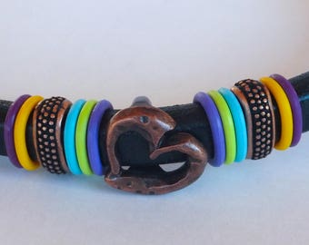 Black leather bracelet with a heart slide