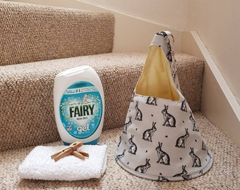 Sitting rabbit conical peg bag in grey or blue.