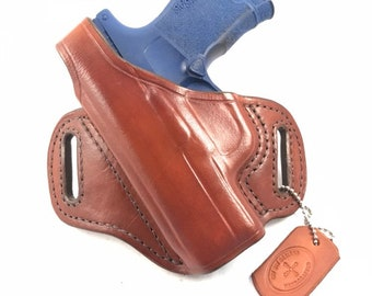 SIG p365 with retention strap - Handcrafted Leather Pistol Holster