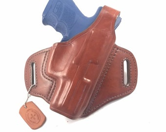 HK VP-9 SK with retention strap - Handcrafted Leather Pistol Holster