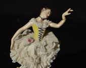 Broken Ballerina Aelteste Volkstedter porcelain ballerina with lace skirt and yellow bodice.