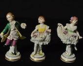 Muller Co. Volkstedt Dresden boy and 2 girls dancing figurines