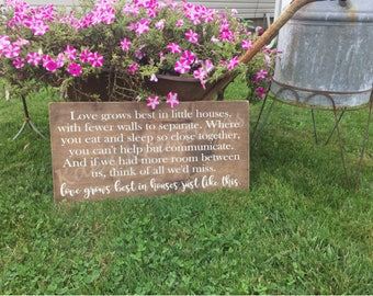 Love grows best in little houses like this, family wood sign