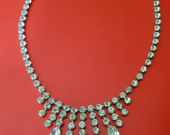 A beautiful vintage art deco sterling silver and rhinestone necklace. Circa 1930s. By Jay flex.