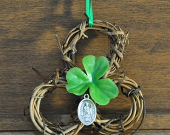Unique Irish Shamrock-Shaped Wreath Featuring a St. Patrick & St. Brigid Dual Medal, a Shamrock, and a Green Hanging Ribbon