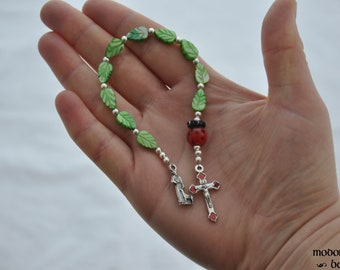 Adorable St. Francis One-Decade Kids' Rosary With Ladybug Our Father Bead, Green Leaf Beads, and Silver & Red Crucifix